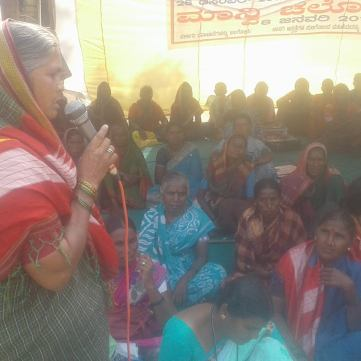 Chinnamma addressing women's rally